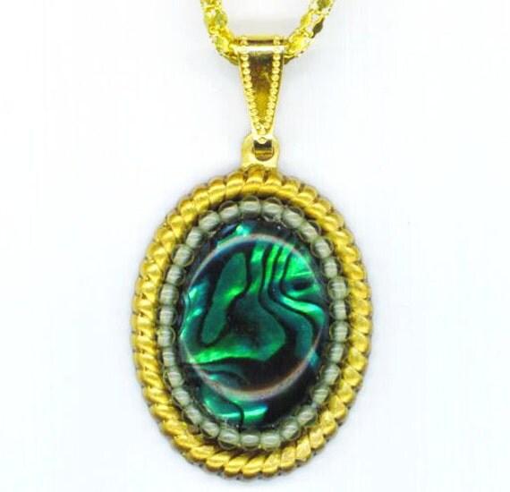 Beaded Green Abalone Pendant . Genuine Peridot Beads . Statement Pendant  . Raw Brass Rope Frame - Emerald Shell by enchantedbeads on Etsy