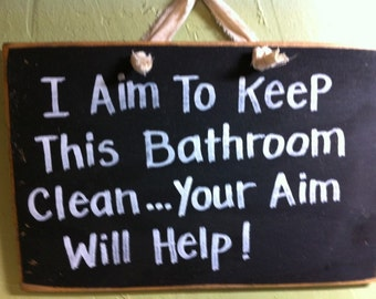 I Aim to Keep this bathroom clean your Aim will help sign