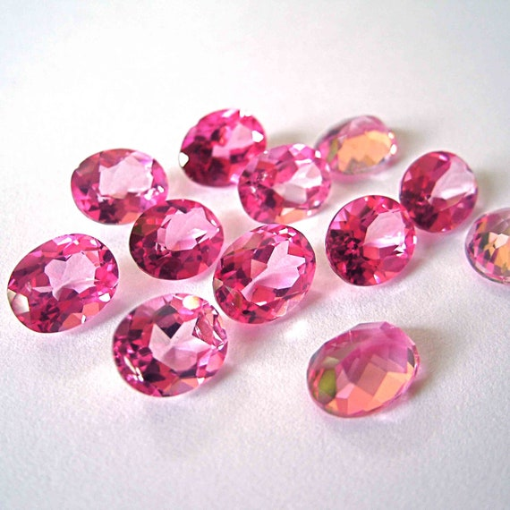 faceted gemstones pink topaz oval brilliant cut by
