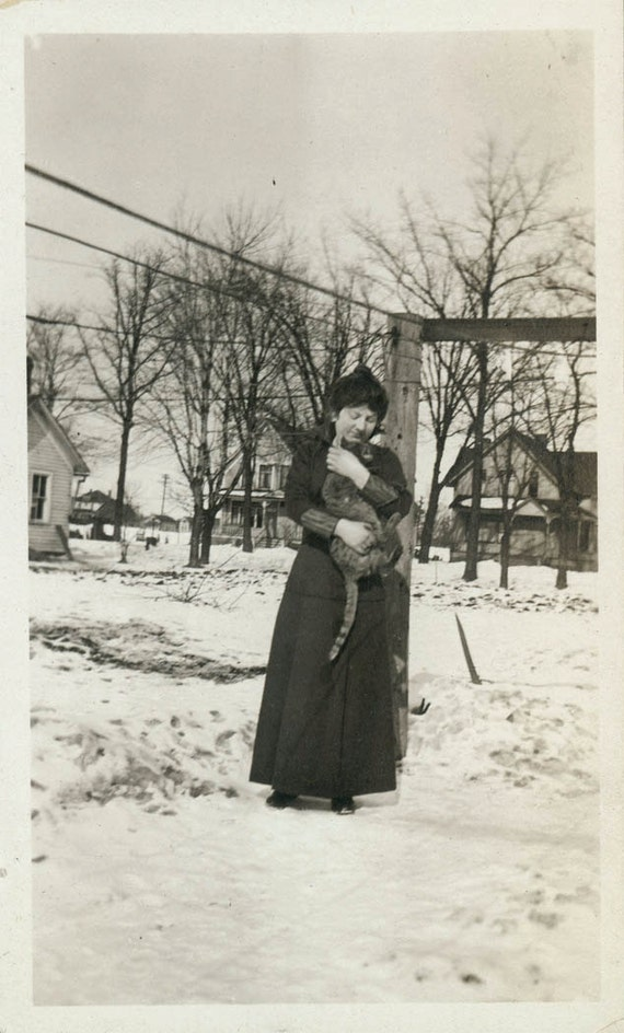 vintage photo Woman Loves her CAt or bobcat in the Snow