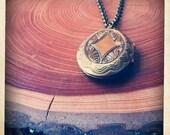long decorative locket necklace - bronze oval