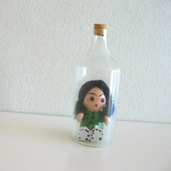 Vintage Wooden Miniature Figurine in a Glass Bottle