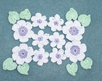 10 purple and white crochet applique flowers with green leaves  --  1767