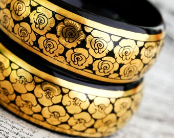 Pair of black and gold leaf Burmese lacquerware bangles