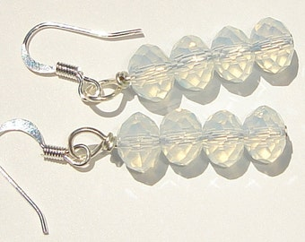 a sparkly stack of faceted moonstone pierced dangle hand made wire wrapped earrings by Ziporgiabella