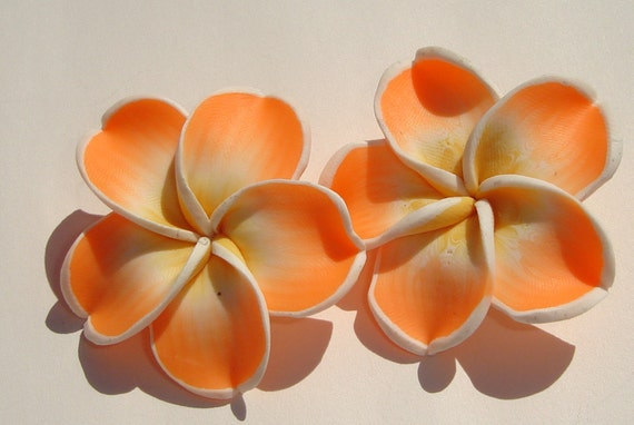 large sweet orange yellow and white polymer clay plumeria hibiscus flower clip on earrings