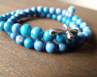 Turquoise bead wrap with cross charm link.