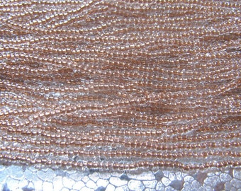 Seed Bead 11/0 Copper Lined Clear  about 3000 Beads