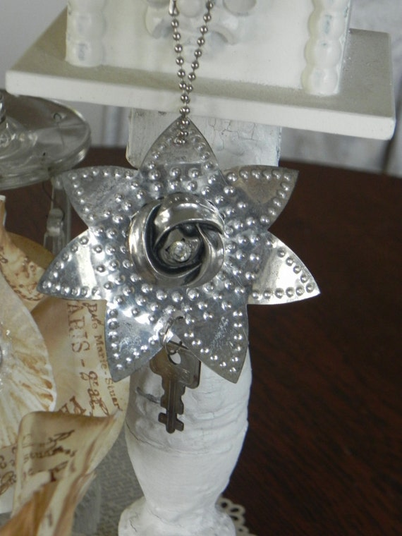 Old punched metal reflector christmas ornament w vintage