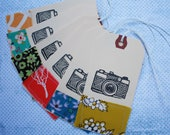Stamped and stitched camera tags