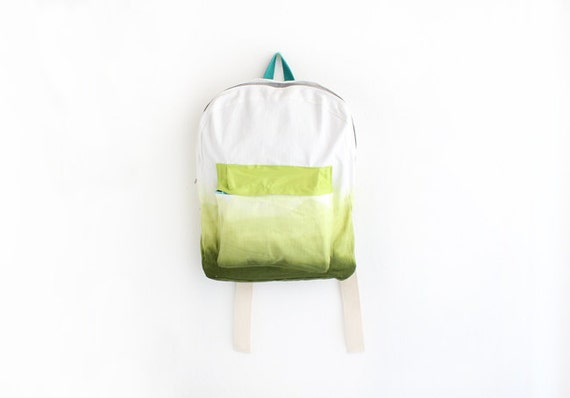 olive green backpack with lime green pouch