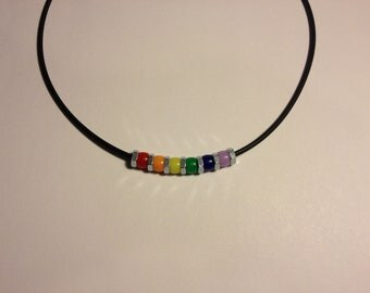 Rainbow beads and hex nuts on rubber cord