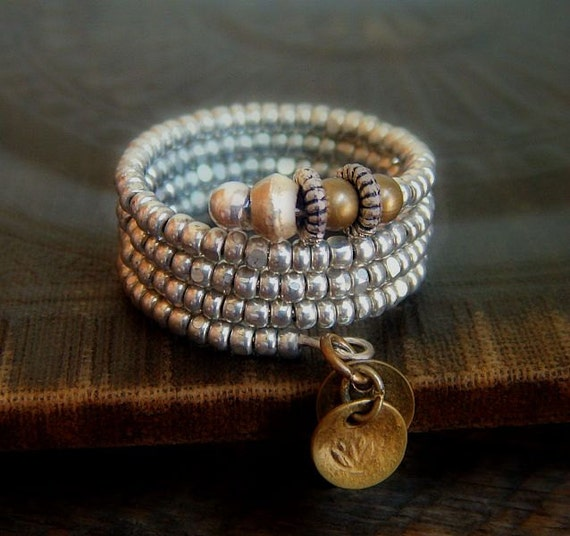 RESERVED-Faceted Silver Glass Beads, African Spacers, Brass rounds and Discs Adjustable Wire Ring