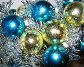 Aluminum Tinsel Christmas Tree, Decorated, Shiny Brite Bulbs, Santa Land Bulbs, 24 bulbs, Blue & Gold