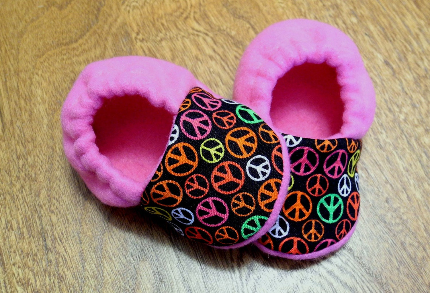 Mod peace signs and pink fleece baby booties by busyhandsboutique