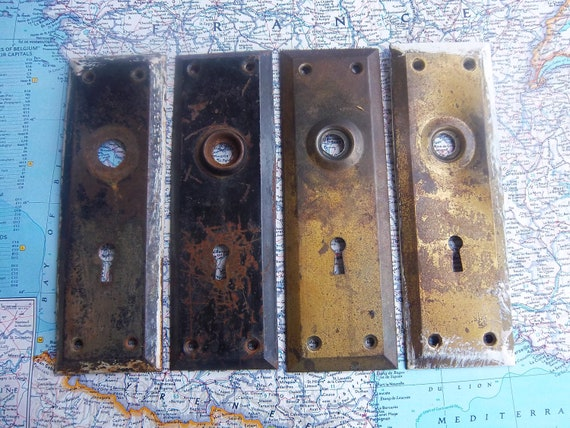 4 vintage distressed metal doorplates with keyholes for decor or projects