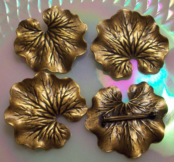 4 Antique Brass Coated art nouveau lily pad Brooches or pins Vintage Brass Stampings In an Antique Brass Coated Finish or Patina