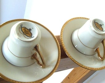 Pair of Rosenthal Ivory Bavaria Demitasse Cups and Saucers