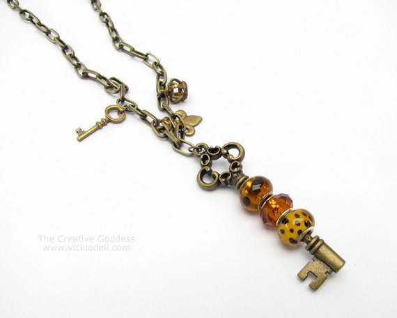 Antique Brass and Amber Large Hole Bead Key and Charm Necklace