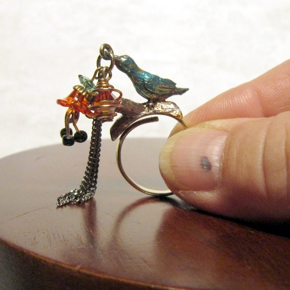 Vintage brass bird ring with dangling charms