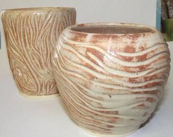 Set of two orange & white vases hand carved