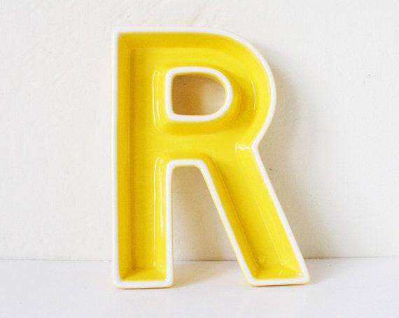 Yellow ceramic letter R