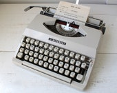 vintage manual typewriter. 1960s Viscount portable. Dove gray. Comes with case. Works beautifully.  60s industrial mod