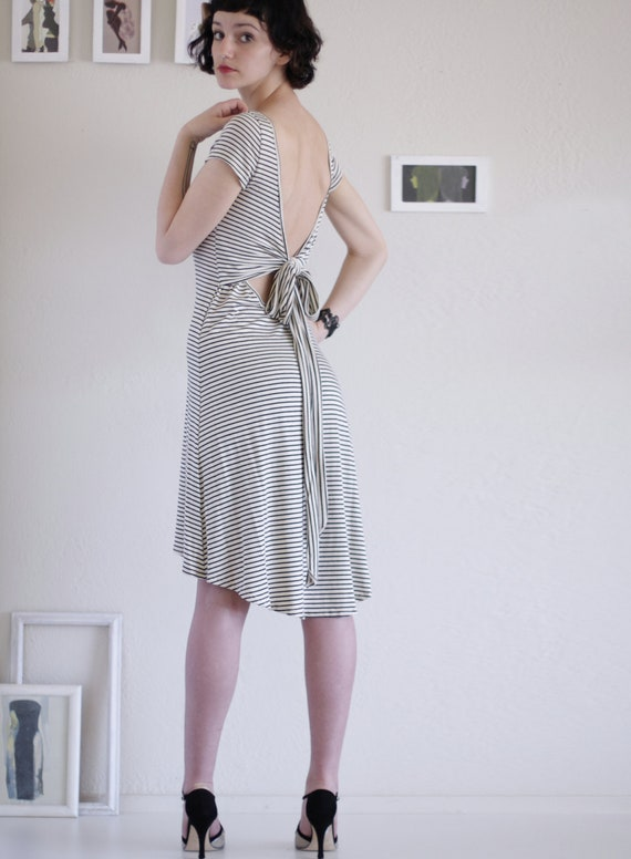 Unique fashion . Stripe dress . Knee length Dress . High Low Stripe Dress -Big fan of stripes and bird - size Small