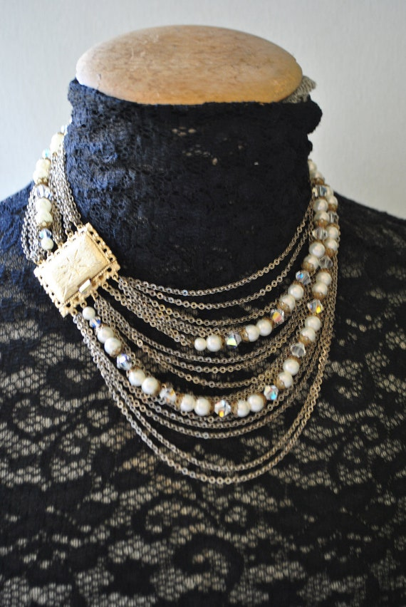 Glamour vintage 50s ,17 strand , drape, flapper style , bib necklace with a large bar clasp.