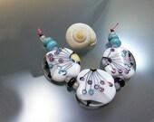 """Melanie Moertel Lampwork Beads - White glass bead mini set of 3 plus 6 spacers - """"Three Butterfly Wings"""""""