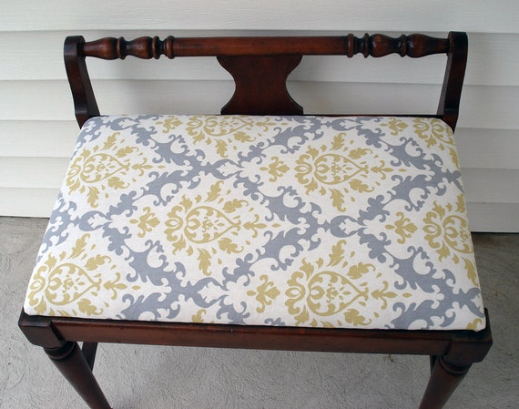 Low vintage bedroom chair with clean lines and modernized seat fabric