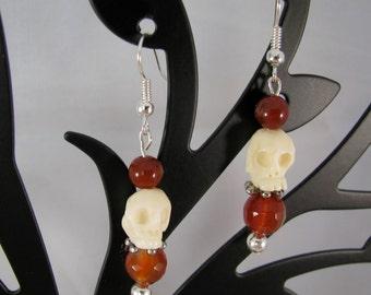 Medium stone skulls with dark orange-amber beads sterling dangle earrings