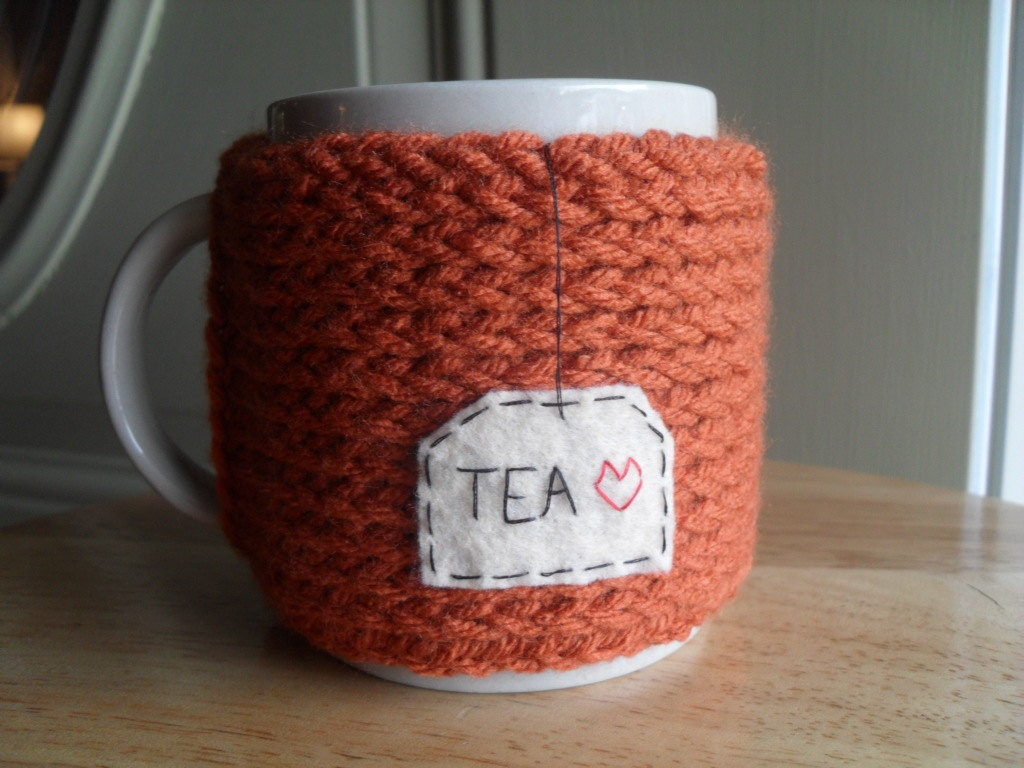 knitted mug cozy cup cozy in burnt pumpkin orange with felt