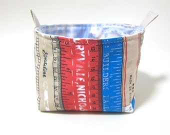 Reversible fabric basket storage bin and organizer - vintage measuring tapes and blue patchwork