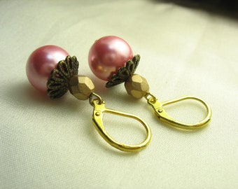 Pink pearl earrings ... bubblegum pink glass pearls with antique brass bead caps and gold faceted rounds ... blowing candy bubbles