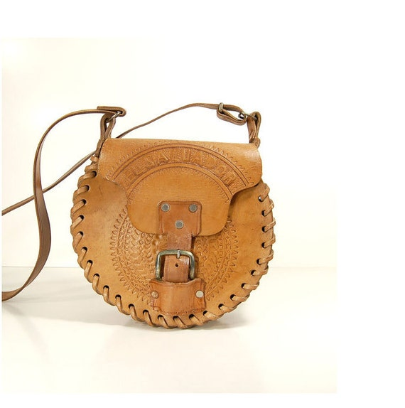 1970s ROUND  tooled stitched saddle leather  bag with buckle