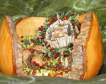 Fox Hallow is Raised Texture Beaded Art and is resting in a  hand turned Apple Wood bowl
