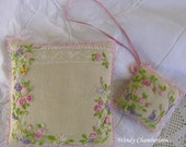 Hand embroidered floral pincushion and scissor keep.