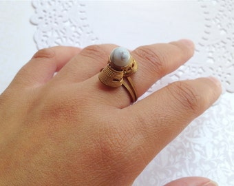 Vintage Gold Tone Adjustable Ring with Light Blue Natural Stone Accent. Rustic. Gray. Round Stone. Adjustable Ring. 1970s. Pastel Blue.