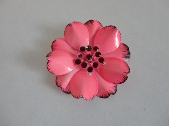 VINTAGE pink and black enamel FLOWER BROOCH with red rhinestone center
