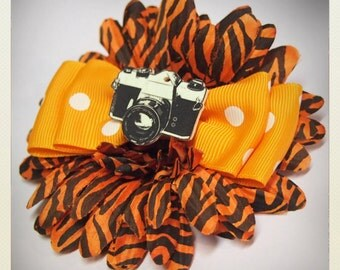 Pin Up-style orange animal print Hair flower with retro vintage camera