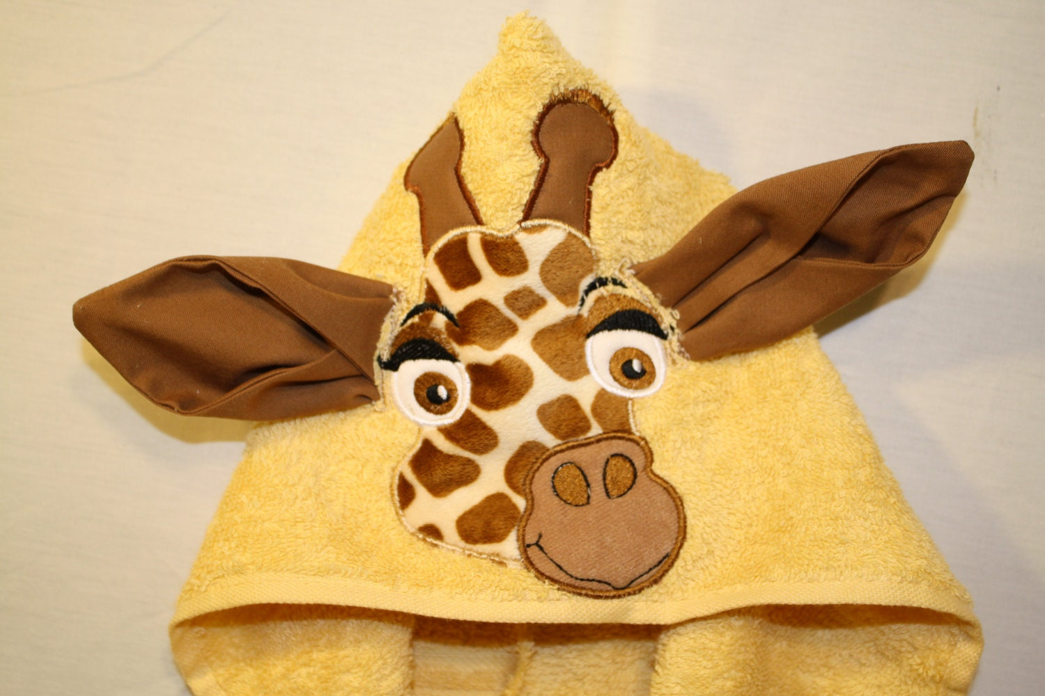 custom embroidered giraffe hooded towel by personalizepeacock