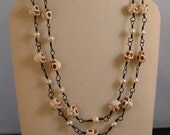 Double-strand skull necklace of howlite beads and pearls