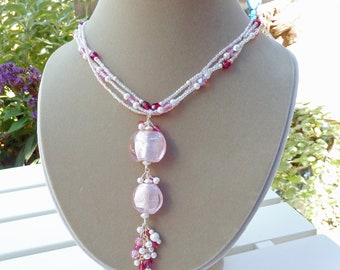 Pendant necklace w/pink foil puffed coins on seed bead and glass bead triple chain
