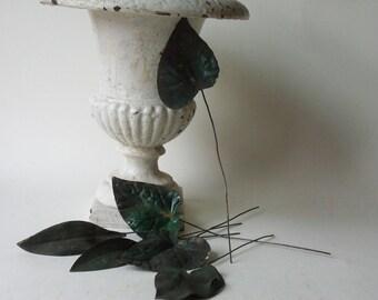 six vintage rusty tin leaves