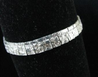 Silver tone metal hammered look bracelet