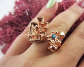 Adjustable Bizmuth Crystal Ring in Rose Gold with Blue Topaz