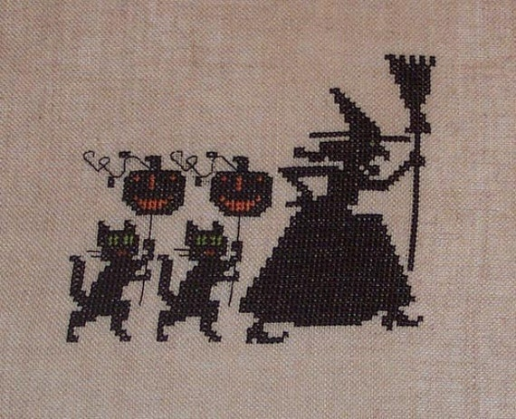 Completed Cross Stitch Witch, Black Cats and Pumpkins Parade