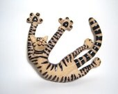 cat sculpture stretching on back