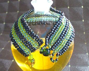 Green beadwork bracelet, herringbone weave, cuff bracelet